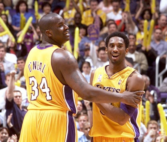 The Lakers' Shaquille O'Neal and Kobe Bryant share a laugh during the final minutes of the the Lakers' 117-103 victory over the New York Knick at the Staples Center Sunday March 10, 2002. (Photo by Kevin Sullivan, Orange County Register/SCNG)